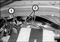 3.2 Соединитель электропроводки (1) и провода высокого напряжения (2) от модуля зажигания.